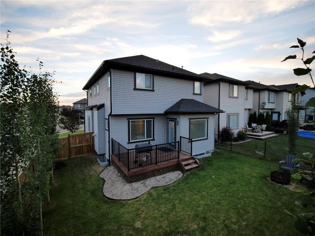 For Sale: 202 Prairie Springs Crescent Southwest, Airdrie, AB | 4 Bed, 2 Bath House for $450,000. See 37 photos!