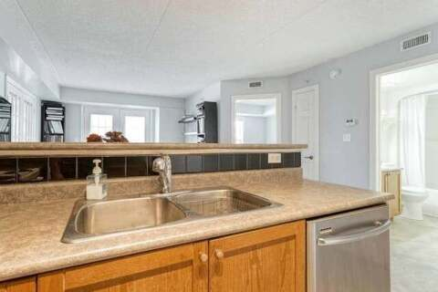 Condo for sale at 1460 Bishops Gt Unit 203 Oakville Ontario - MLS: W4812516