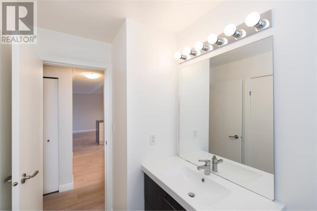 For Sale: 205 - 1068 Tolmie Avenue, Victoria, BC | 2 Bed, 2 Bath House for $399,900. See 18 photos!