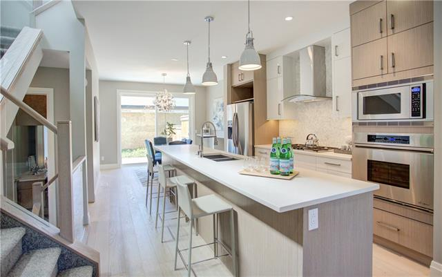 For Sale: 205 11 Street Northeast, Calgary, AB | 3 Bed, 2 Bath Townhouse for $749,000. See 33 photos!
