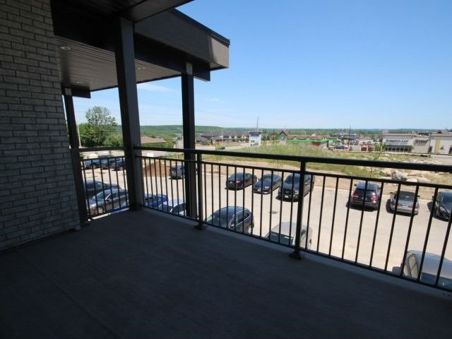 For Sale: 205 - 295 Cundles Road, Barrie, ON | 2 Bed, 2 Bath Condo for $424,999. See 14 photos!