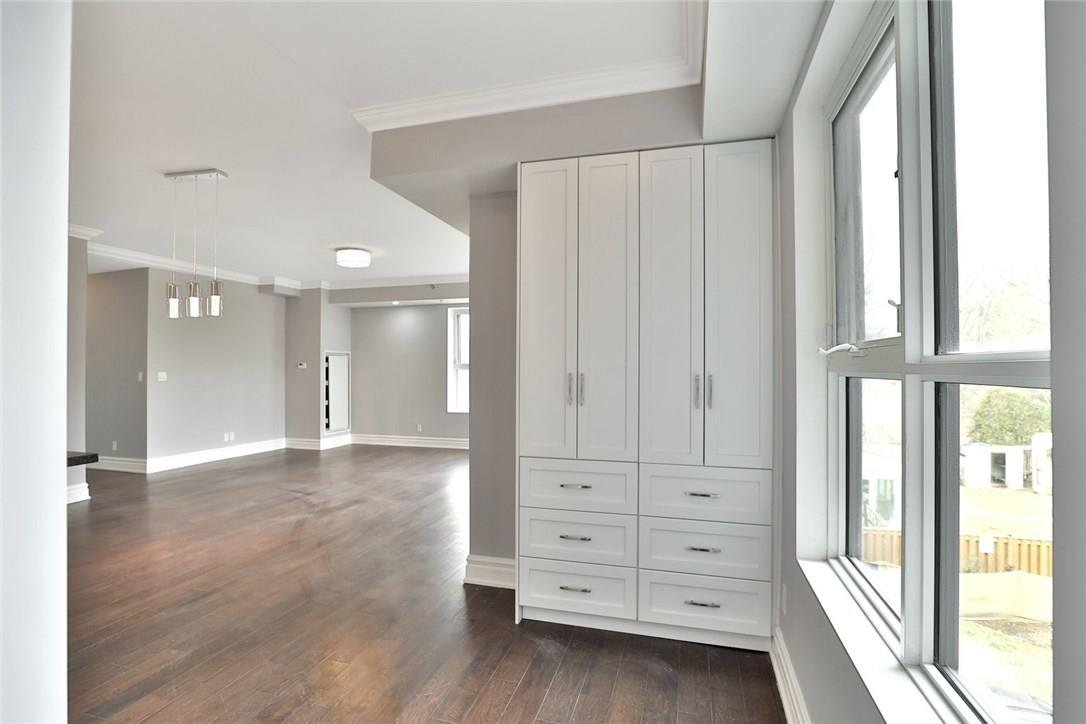 For Sale: 205 - 34 Plains Road East, Burlington, ON | 2 Bed, 2 Bath House for $589,500. See 30 photos!
