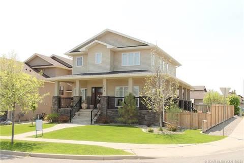 House for sale at 206 Riverstone Blvd W Lethbridge Alberta - MLS: LD0168044