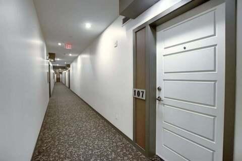 Condo for sale at 207 Sunset Dr Cochrane Alberta - MLS: A1037476