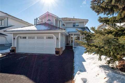 208 Woodford Close Southwest, Calgary   Image 1
