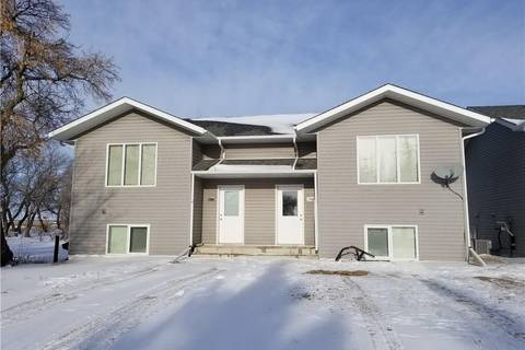 Townhouse for sale at 209 2nd Ave NW Unit A & B Watson Saskatchewan - MLS: SK792864