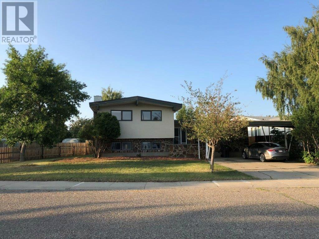 For Sale: 21 Lafayette Crescent West, Lethbridge, AB | 6 Bed, 4 Bath House for $329,000. See 28 photos!
