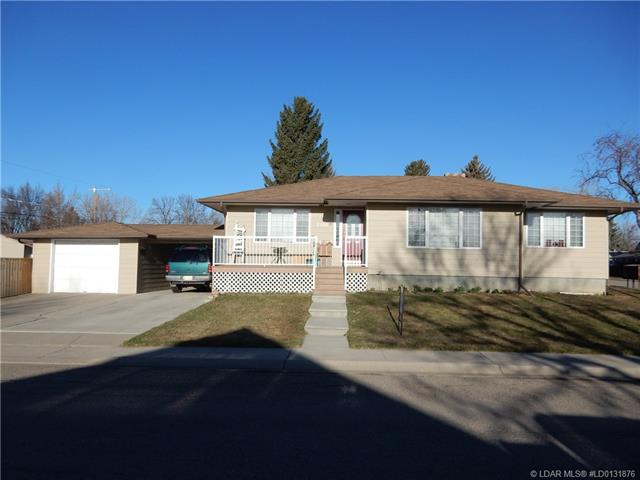 For Sale: 2104 18 Street, Coaldale, AB | 5 Bed, 2 Bath House for $296,000. See 21 photos!