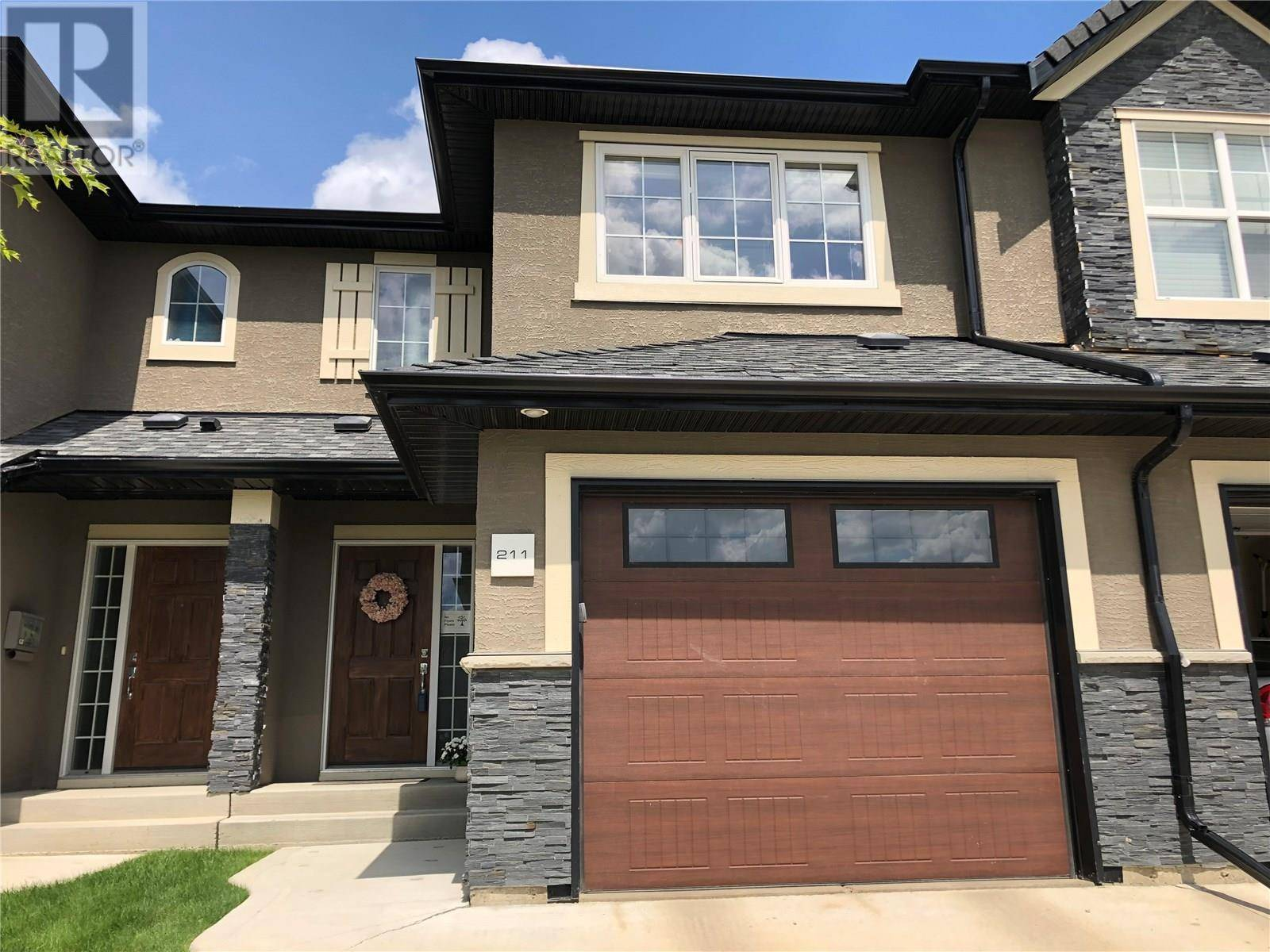 Townhouse for sale at 455 Rempel Ln Unit 211 Saskatoon Saskatchewan - MLS: SK778413