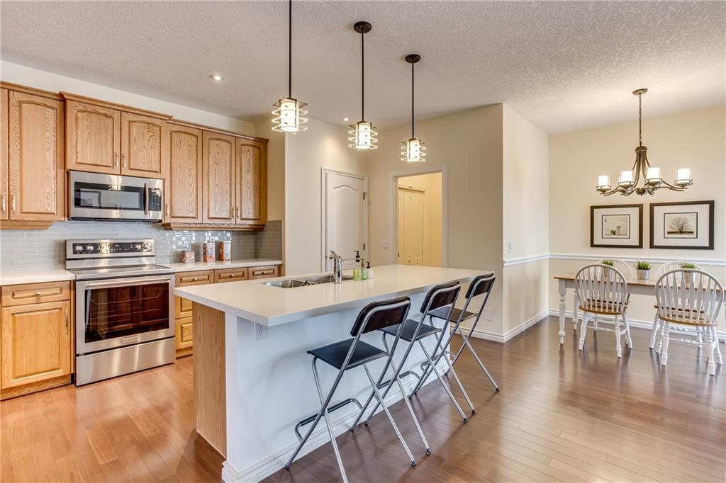 For Sale: 2128 Vimy Way Southwest, Calgary, AB | 4 Bed, 3 Bath House for $1,099,000. See 45 photos!