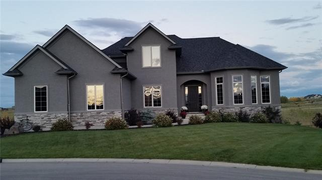 For Sale: 214 Montenaro Place, Rural Rocky View County, AB | 4 Bed, 4 Bath House for $839,500. See 39 photos!