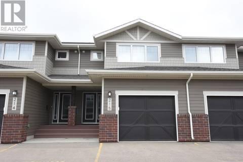 Townhouse for sale at 4002 Sandhill Cres Unit 215 Regina Saskatchewan - MLS: SK768773
