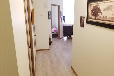 Condo for sale at 72 Quigley Dr Unit 215 Cochrane Alberta - MLS: C4236522