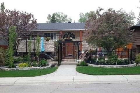 House for sale at 216 Lake Acadia Green Southeast Calgary Alberta - MLS: C4299536