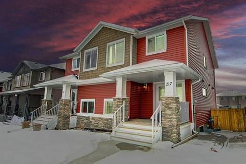 Townhouse for sale at 217 River Heights Dr Cochrane Alberta - MLS: C4281433