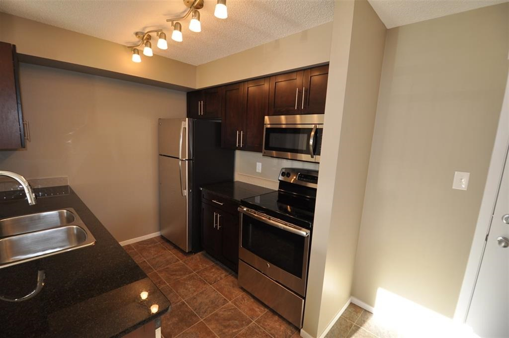 For Sale: 221 - 18126 77 Street, Edmonton, AB | 2 Bed, 2 Bath Condo for $199,900. See 18 photos!