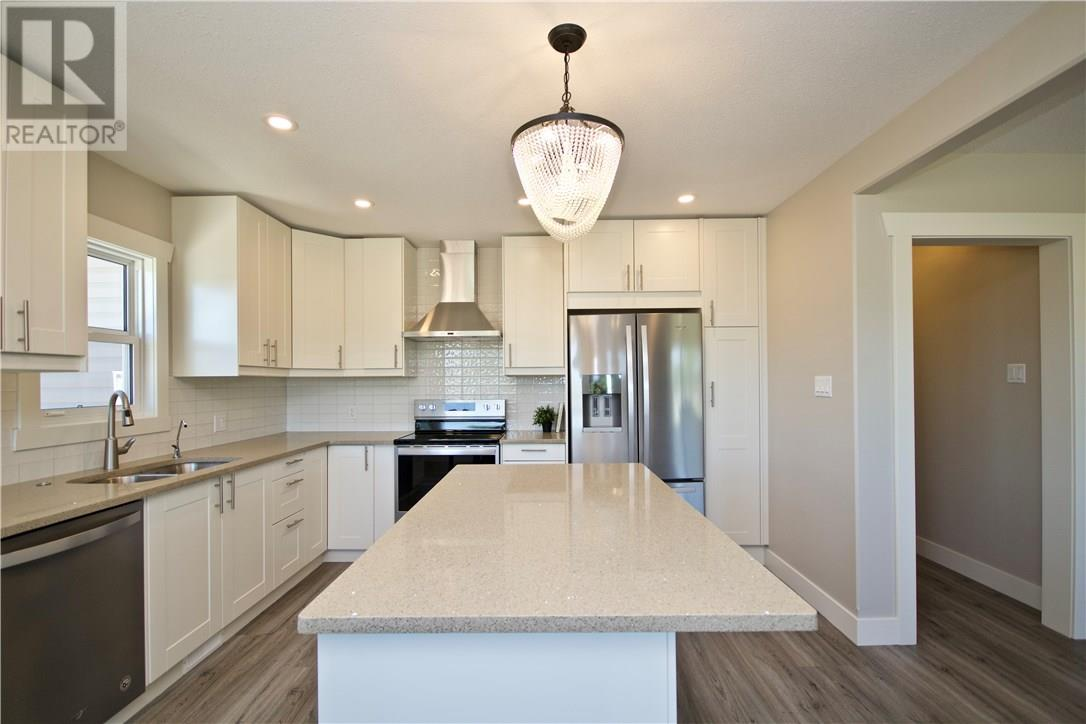 For Sale: 221 9 Street Southwest, Medicine Hat, AB | 4 Bed, 2 Bath House for $397,500. See 29 photos!