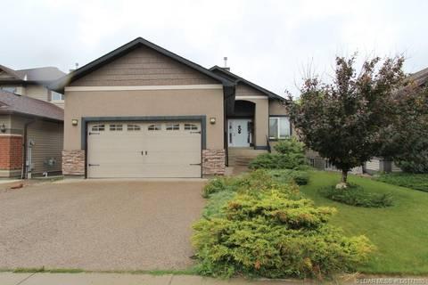 House for sale at 225 Couleecreek Manr S Lethbridge Alberta - MLS: LD0171985