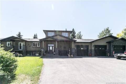 Home for sale at 231049 Township Road 100a  Rural Lethbridge County Alberta - MLS: LD0164919