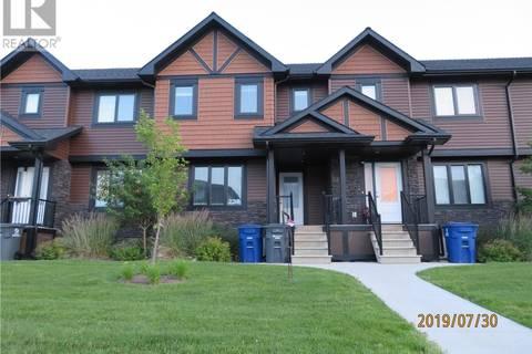 Townhouse for sale at 237 Rajput Wy Saskatoon Saskatchewan - MLS: SK778964