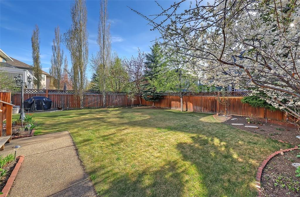 For Sale: 238 Strathridge Place Southwest, Calgary, AB   3 Bed, 2 Bath House for $759,000. See 50 photos!