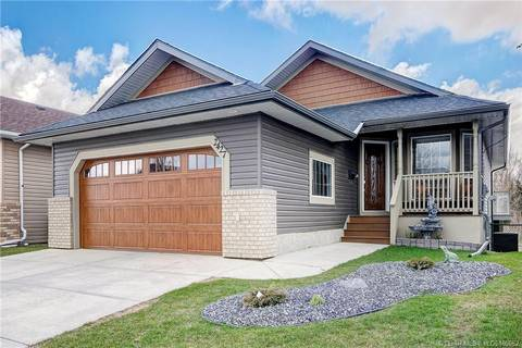 House for sale at 2427 Morris Cres SE Airdrie Alberta - MLS: LD0165662