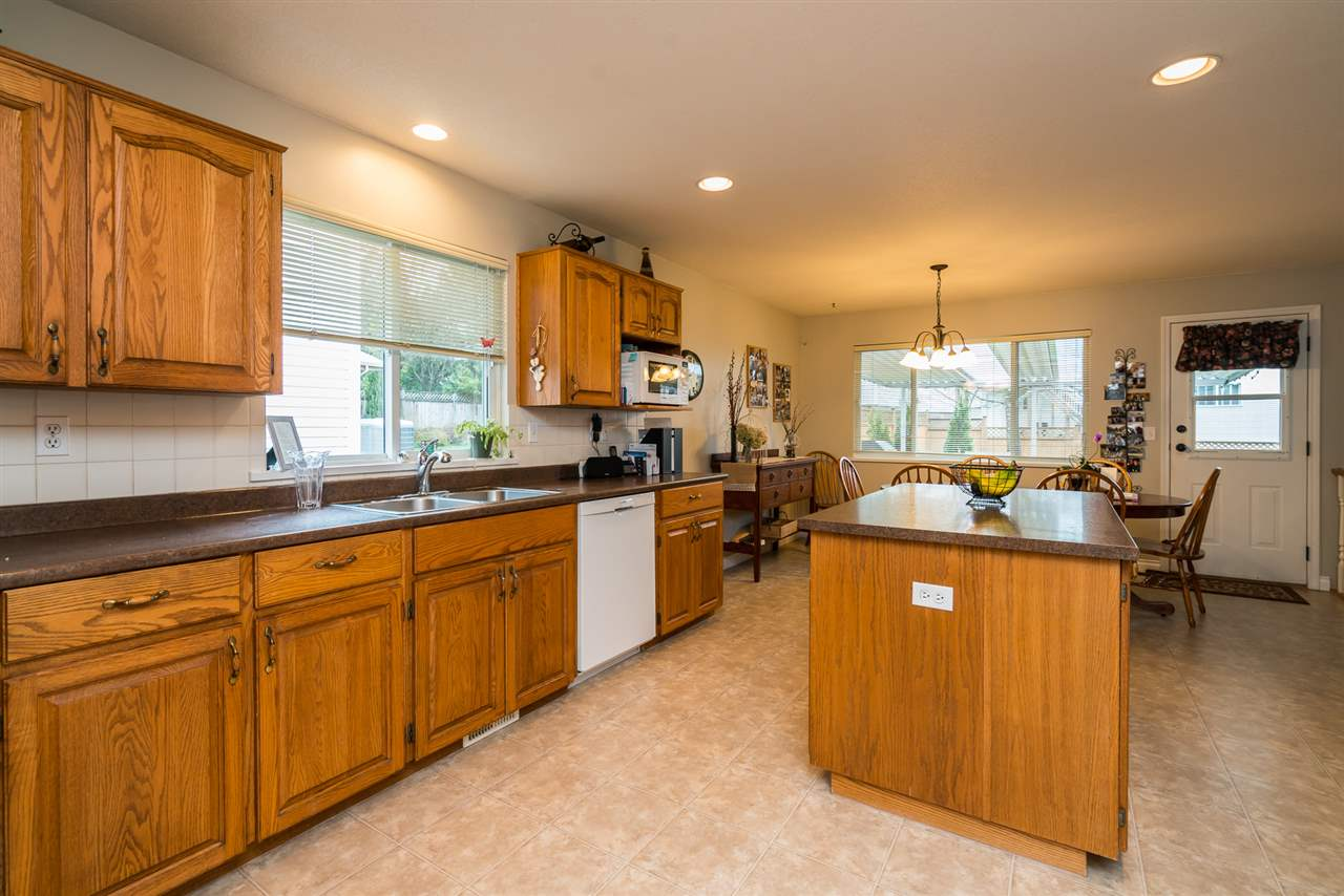 For Sale: 2450 268 Street, Langley, BC | 5 Bed, 4 Bath House for $949,000. See 20 photos!