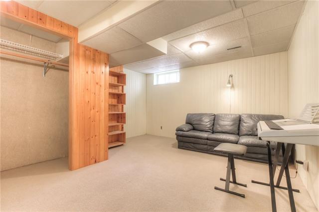 For Sale: 25 Spokane Street Southwest, Calgary, AB | 4 Bed, 2 Bath House for $500,000. See 43 photos!