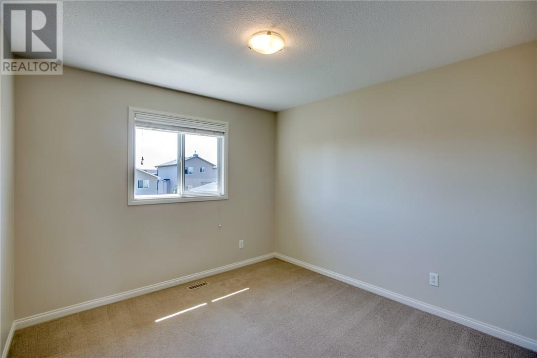 For Sale: 26 Keystone Terrace West, Lethbridge, AB | 3 Bed, 3 Bath House for $299,900. See 24 photos!