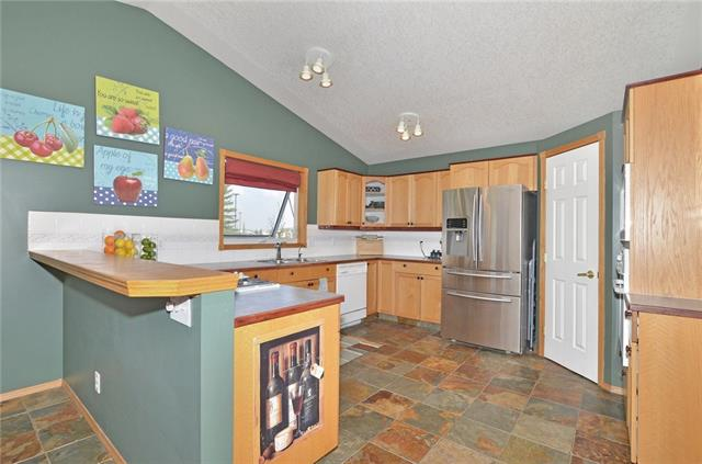 For Sale: 28 Cimarron Meadows Way, Okotoks, AB | 4 Bed, 3 Bath House for $387,000. See 38 photos!