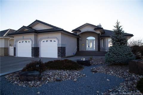 House for sale at 28 Fairmont Pt S Lethbridge Alberta - MLS: LD0154685