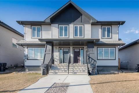 Townhouse for sale at 285 Coalbanks Blvd W Lethbridge Alberta - MLS: LD0161843