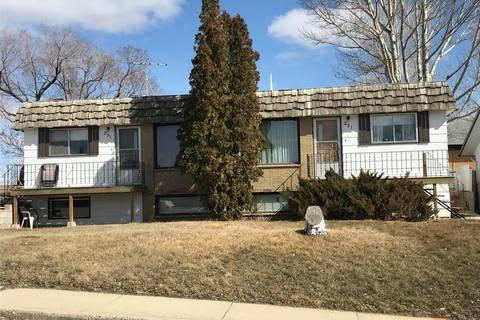 Townhouse for sale at 291 18th Ave NE Swift Current Saskatchewan - MLS: SK764665