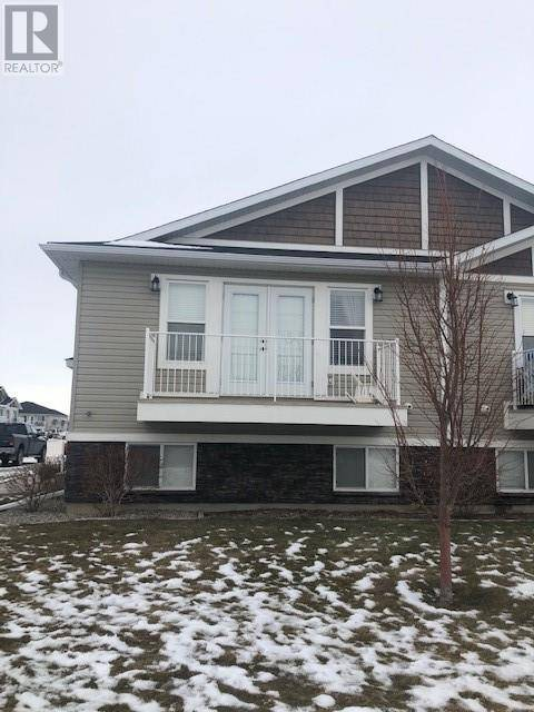 Townhouse for sale at 23 Cougar Cove N Unit 3 Lethbridge Alberta - MLS: ld0186326
