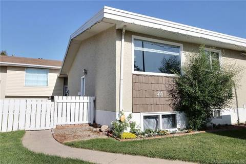 Townhouse for sale at 511 26 St N Unit 3 Lethbridge Alberta - MLS: LD0175792