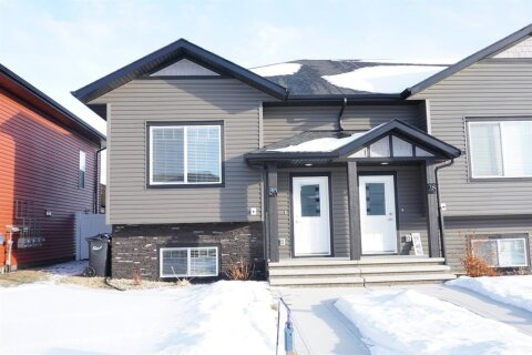 Townhouse for sale at 30 Hutton Pl SW Penhold Alberta - MLS: A1022993