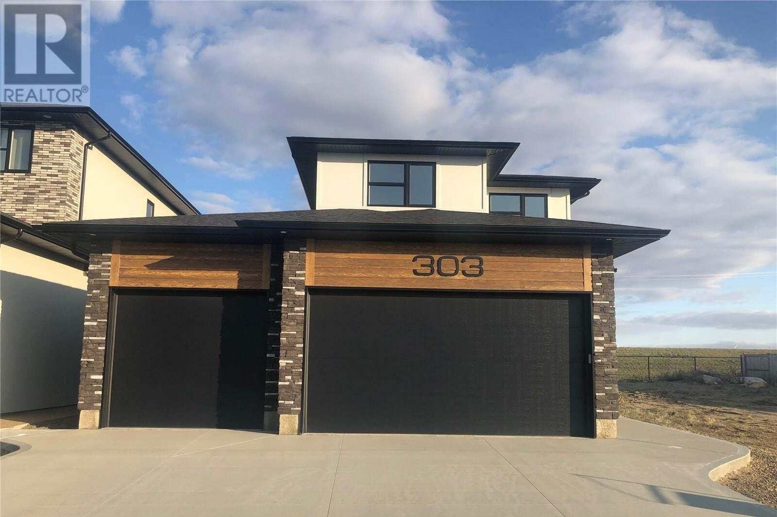 House for sale at 303 Arscott Cres Saskatoon Saskatchewan - MLS: SK810177