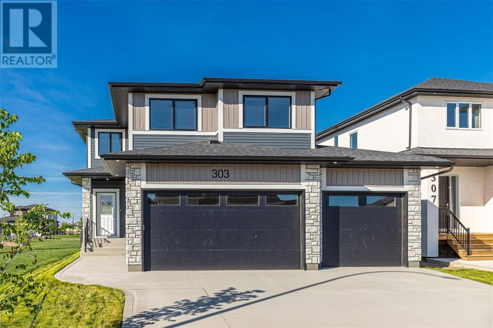 House for sale at 303 Bolstad Wy Saskatoon Saskatchewan - MLS: SK776822
