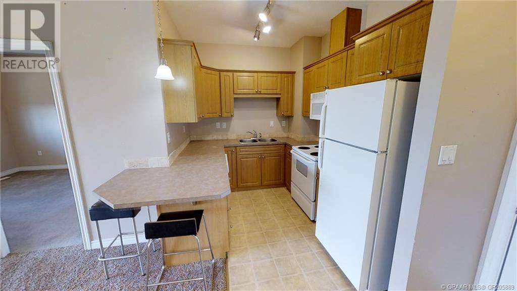 Condo for sale at 9225 Lakeland Dr Unit 304 Grande Prairie Alberta - MLS: GP205889