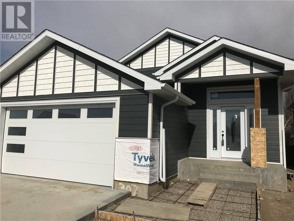 House for sale at 307 Greenwood Pl Coalhurst Alberta - MLS: ld0189053