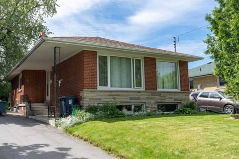 House for sale at 31 Grassington Cres Toronto Ontario - MLS: E4489707