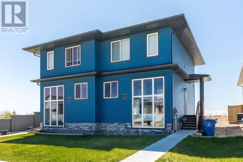Townhouse for sale at 310 Coalbanks Blvd West Lethbridge Alberta - MLS: LD0188753