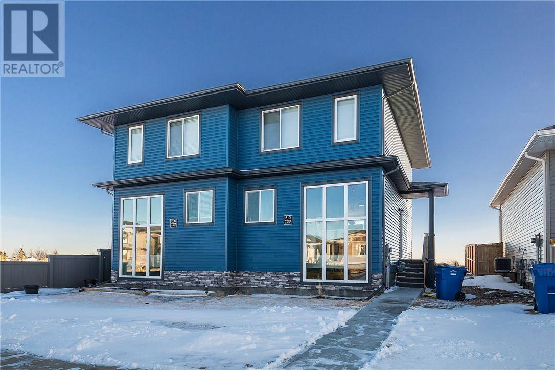 Townhouse for sale at 310 Coalbanks Blvd W Lethbridge Alberta - MLS: ld0188753