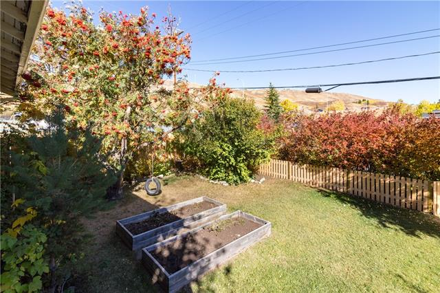 For Sale: 313 Ross Avenue, Cochrane, AB | 4 Bed, 2 Bath House for $349,900. See 29 photos!