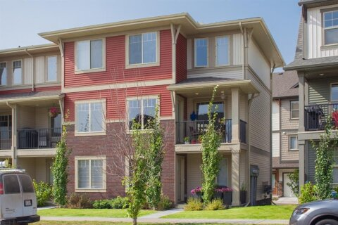 Townhouse for sale at 32 Horseshoe Cres Cochrane Alberta - MLS: A1035232