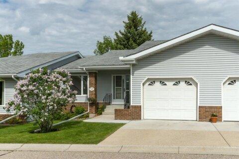 Townhouse for sale at 32 Vandoos Villas NW Calgary Alberta - MLS: A1031555