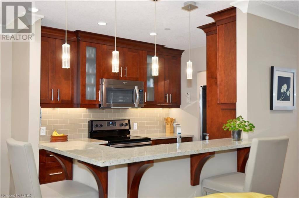 Condo for sale at 414 Sugarcreek Tr Unit 320 London Ontario - MLS: 218022