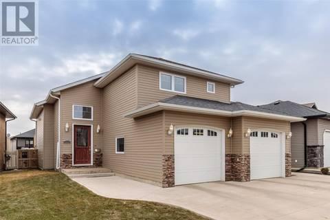 House for sale at 323 Hampton Blvd West Saskatoon Saskatchewan - MLS: SK764786