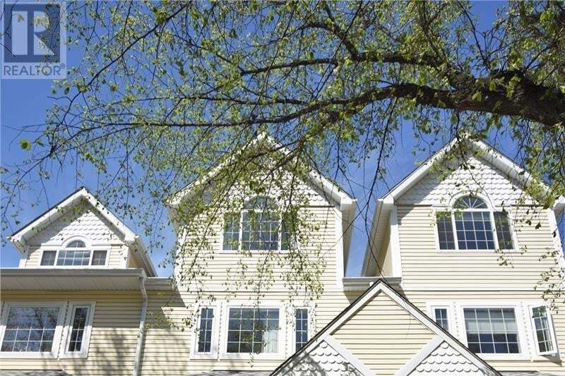 Townhouse for sale at 327 10th St E Saskatoon Saskatchewan - MLS: SK809139
