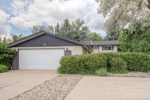 House for sale at 33 Dalhousie Rd W Lethbridge Alberta - MLS: LD0170951